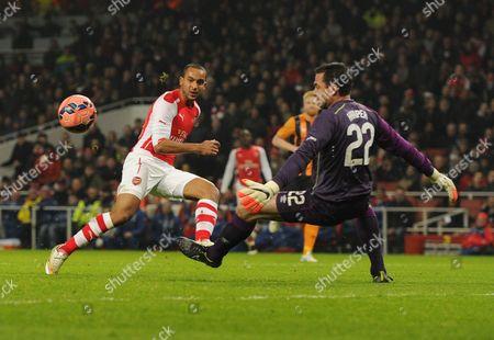Theo Walcott of Arsenal shoots wide of Hull City Goalkeeper Steve Harper