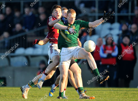 Westmeath's David Whelan and Ciaran McConnell of Meath battle for possession