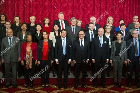 (Front row, from L) France's Defence minister Jean-Yves Le Drian, Justice minister Christiane Taubira, minister for Ecology, Sustainable Development and Energy Segolene Royal, Prime minister Manuel Valls, president Francois Hollande, Foreign Affairs minister Laurent Fabius, Education minister Najat Vallaud-Belkacem, (second row, from L) Junior minister for State reform and Simplification Thierry Mandon, Overseas Territories minister George Pau-Langevin, Culture minister Fleur Pellerin, Housing minister Sylvia Pinel, Agriculture minister and Government spokesperson Stephane Le Foll, Economy and Industry minister Emmanuel Macron, minister for State Reform and Public Services Marylise Lebranchu, minister for Cities, Youth and Sport Patrick Kanner, (back row, from L) junior minister for Urban Policy Myriam El Khomri, junior minister for Digital Economy Axelle Lemaire, junior minister for Women's Rights Pascale Boistard, junior minister for Family, Elderly and Autonomy Laurence Rossignol, junior Budget minister Christian Eckert, junior minister for Higher Education and Research Genevieve Fioraso, junior minister for Veterans Jean-Marc Todeschini, junior minister for Disabled People and the Fight Against Exclusion Segolene Neuville and junior minister for Trade, Handicraft and Social and Solidarity Economy Carole Delga pose for a family photo at the Elysee Palace