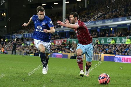 Matthew Jarvis of West Ham United complains about an infringement by Seamus Coleman of Everton
