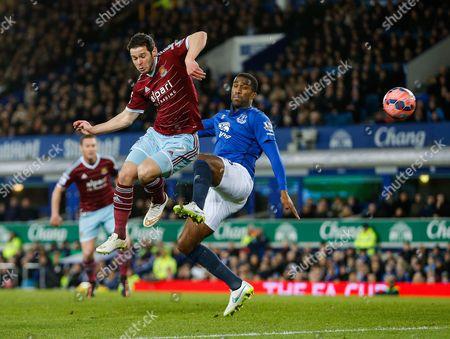 Matthew Jarvis of West Ham flicks the ball towards goal as Sylvain Distin of Everton challenges