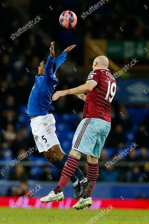Samuel Eto'o of Everton and James Collins of West Ham compete in the air