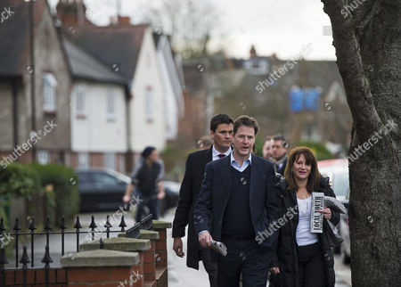 Liberal Democrat Leader Nick Clegg with Lynne Featherstone MP, posting leaflets during a visit to Hornsey, North London, to launch the party's 2015 election cabinet