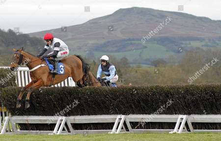 LIFE AND SOUL (Jason Maguire) jumps ahead of winner SIR VALENTINO (Paddy Brennan) during The Ludlow Club Novices Limited Handicap Chase Ludlow