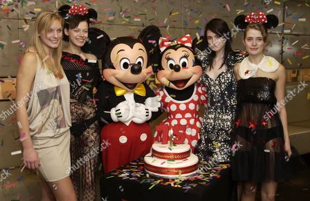 (L TO R) MODELS WEARING DRESSES DESIGNED BY WARREN NORONHA, JULIEN MACDONALD, HOUSE OF JAZZ AND SARA BERMAN HAVING BEEN COMMISSIONED BY WALT DISNEY TO CELEBRATE 75TH BIRTHDAY OF MICKEY AND MINNIE MOUSE
