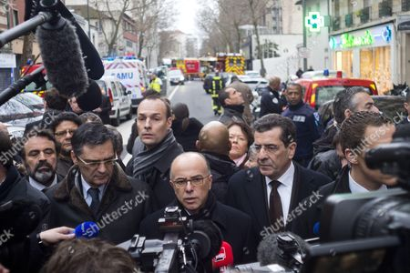 Patrick Devedjian with French Interior Minister Bernard Cazeneuve talks to the media at the site after shooting on the morning in Montrouge