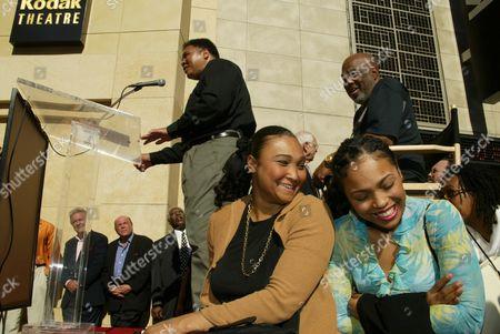 Muhammad Ali, Howard Bingham, and daughters Miya and Hana