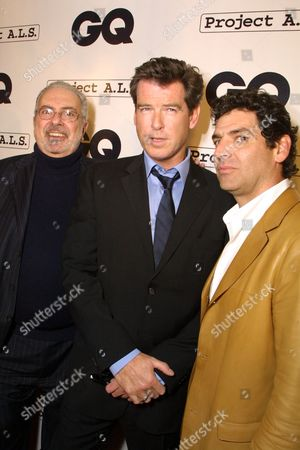 """Stock Photo of 02/15/01  West Hollywood, CA Tom Florio (Publisher-GQ Magazine), Pierce Brosnan and Art Cooper (Editor-in-Chief -GQ Magazine) at GQ Magazines 2nd Annual """"Hollywood Issue"""". Held at The Factory, with special live performance by Tenacious D. Featuring a silent auction benefeting PROJECT A.L.S. Photo®Eric Charbonneau/BEI"""