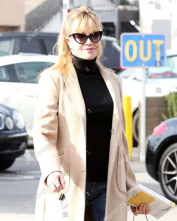 Melanie Griffith with a copy of 'Sophie's World' by Jostein Gaarder