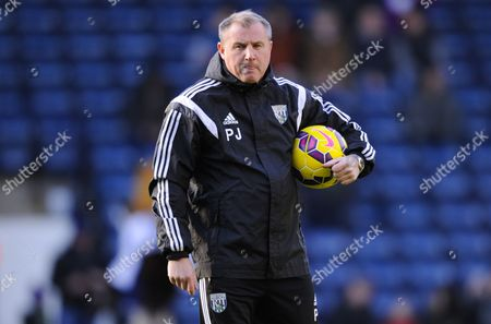Stock Picture of West Bromwich Albion Coach Paul Jewell takes charge of pregame warm-ups