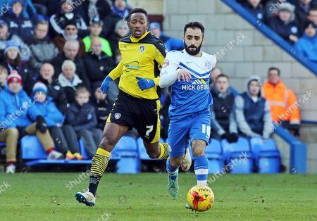 Peterborough United's Erhun Oztumer gets away from Colchester United's Sanchez Watt