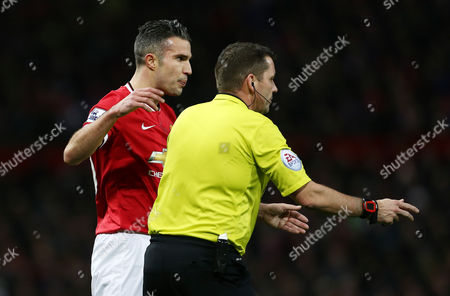 Robin van Persie of Manchester United reacts towards referee Mr Phil Dowd