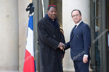 French President Francois Hollande (R) welcomes Benin's President Yayi Boni at the Elysee Palace before attending a Unity rally