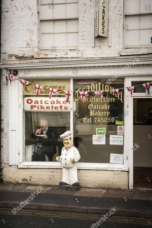 Nick Hancock, in window, at London Road Oatcakes in Stoke-on-Trent