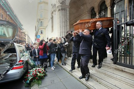 The coffin leaves the church