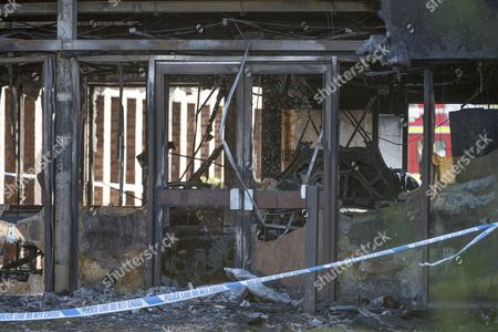 Stock Photo of A burnt out vehicle in the main reception of the South Oxfordshire District Council building in Crowmarsh Gifford