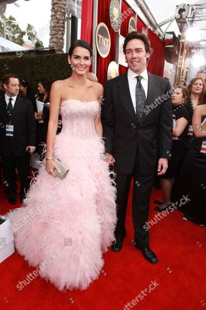LOS ANGELES, CA - JANUARY 30: Angie Harmon and Jason Sehorn at the Arrivals for the 17th Annual Screen Actors Guild Awards on January 30, 2011 at the Shrine Auditorium in Los Angeles, California.