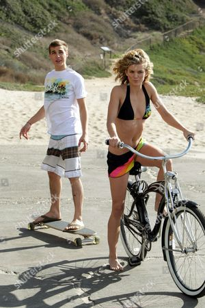 MALIBU, CA - DECEMBER 13: Cody Linley and Annalynne McCord at the new Op campaign on December 13, 2008 in Malibu, California.