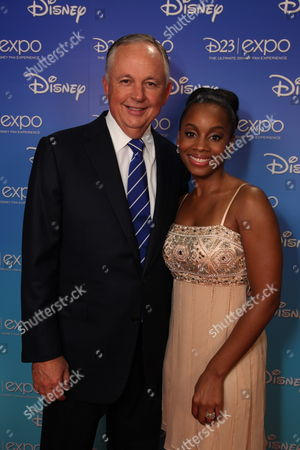 ANAHEIM, CA - SEPTEMBER 10: Disney's Dick Cook and Anika Noni Rose during the Opening Ceremony of Disney's Inaugural D23 Convention on September 10, 2009 at the Anaheim Convention Center in Anaheim, California.