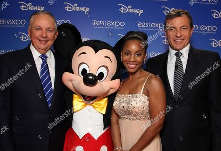ANAHEIM, CA - SEPTEMBER 10: Disney's Dick Cook, Mickey Mouse, Anika Noni Rose and Disney's Bob Iger during the Opening Ceremony of Disney's Inaugural D23 Convention on September 10, 2009 at the Anaheim Convention Center in Anaheim, California.