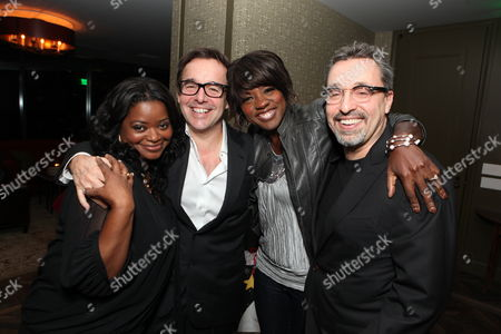 LOS ANGELES, CA - DECEMBER 22: Octavia Spencer, Producer Chris Columbus, Viola Davis and Producer Michael Barnathan at a reception celebrating DreamWorks Pictures 'The Help' on December 22, 2011 in Los Angeles, California.