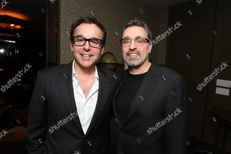 LOS ANGELES, CA - DECEMBER 22: Producer Chris Columbus and Producer Michael Barnathan at a reception celebrating DreamWorks Pictures 'The Help' on December 22, 2011 in Los Angeles, California.