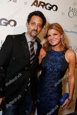 BEVERLY HILLS, CA - OCTOBER 11: Producer Grant Heslov and Founder/President of Children Mending Hearts Lysa Heslov at Warner Bros. 'ARGO' Charity Screening Presented By Samsung Galaxy SIII To Benefit Eastern Congo Initiative And Children Mending Hearts held at The Writers Guild Theatre on October 11, 2012 in Beverly Hills, California. Grant Heslov Lysa Heslov