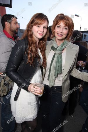 Stock Picture of SANTA MONICA, CA - JUNE 10: Amber Tamblin and Sharon Lawrence at Grey Goose partners With The Young Literati's 3rd Annual Toast on June 10, 2010 at Santa Monica Museum of Art in Santa Monica, California.