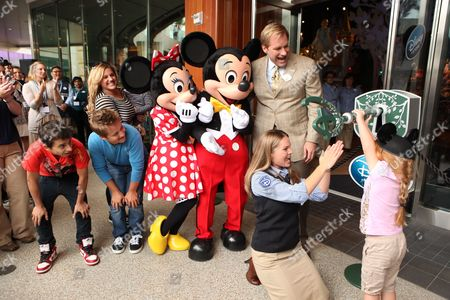 SANTA MONICA, CA - AUGUST 06: Moises Arias, Jason Earles, Marissa Jaret Winokur, Minnie, Mickey, President of Disney Store Worldwide - Jim Fielding and Santa Monica Store Manager Diane Derudder 'Unlock the Imagination ' at the Opening of the new Disney Store at Santa Monica Place on August 05, 2010 at Santa Monica Place in Santa Monica, California.