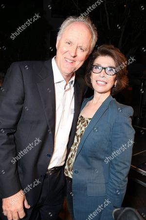 WEST HOLLYWOOD, CA - AUGUST 28: John Lighgow and Exec. Producer Sara Colleton at Showtime's 2010 Emmy Nominees Party on August 28, 2010 at Skybar at Mondrian in West Hollywood, California.