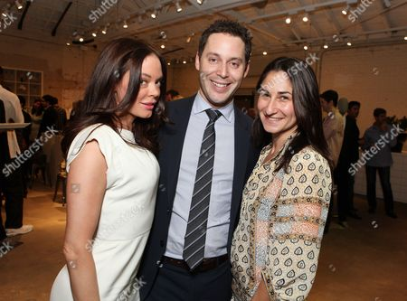 WEST HOLLYWOOD, CA - NOVEMBER 04: Rose McGowan, CAA's Michael Kives and CIS' Deborah Marcus at Theory event benefitting Communities In Schools supported by Grey Goose at Theory on November 4, 2010 in West Hollywood, California. Rose McGowan Michael Kives Deborah Marcus