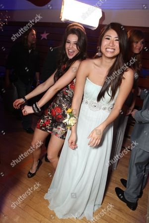 HOLLYWOOD, CA - APRIL 21: Danielle Campbell and Yin Chang at The World Premiere of Disney's 'Prom' at the El Capitan Theatre on April 21, 2011 in Hollywood, California. Danielle Campbell Yin Chang