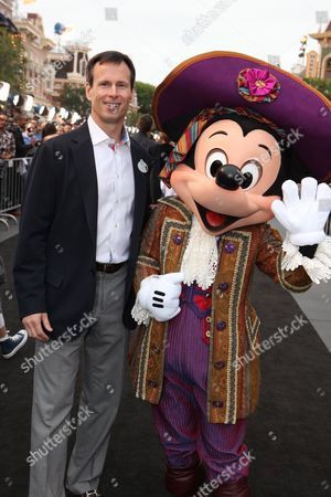 ANAHEIM, CA - MAY 07: Chairman, Walt Disney Parks and Resorts - Tom Staggs and Mickey Mouse at the World Premiere of Disney's 'Pirates of the Caribbean: On Stranger Tides' at Disneyland on May 7, 2011 in Anaheim, California. Tom Staggs Mickey Mouse