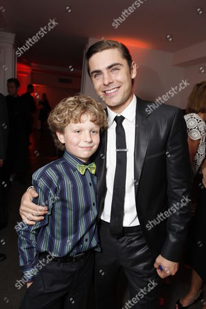 HOLLYWOOD, CA - APRIL 16: Riley Thomas Stewart and Zac Efron at The World Premiere of Warner Bros.' 'The Lucky One' at Grauman's Chinese Theatre on April 16, 2012 in Hollywood, California.
