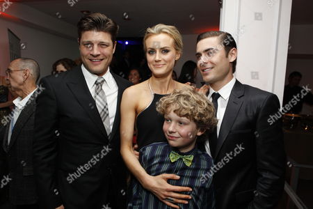 HOLLYWOOD, CA - APRIL 16: Jay R. Ferguson, Taylor Schilling, Riley Thomas Stewart and Zac Efron at The World Premiere of Warner Bros.' 'The Lucky One' at Grauman's Chinese Theatre on April 16, 2012 in Hollywood, California.