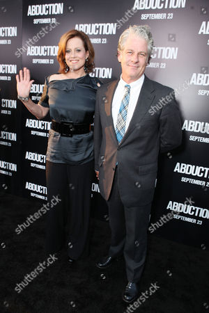 HOLLYWOOD, CA - SEPTEMBER 15: Sigourney Weaver and Jim Simpson at Lionsgate's World Premiere of 'Abduction' at Grauman's Chinese Theatre on September 15, 2011 in Hollywood, California. Sigourney Weaver Jim Simpson