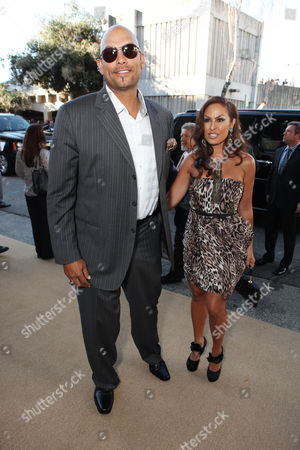 Stock Image of OAKLAND, CA - SEPTEMBER 19: David Justice and Rebecca Villalobos at Columbia Pictures Premiere of 'Moneyball' to Benefit the Fight Against Cancer with Children's Hospital & Research Center in Oakland and Stand Up to Cancer at the Paramount Theatre of the Arts on September 19, 2011 in Oakland, California. David Justice Rebecca Villalobos