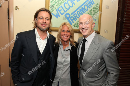 OAKLAND, CA - SEPTEMBER 19: Brad Pitt, EIF's Lisa Paulsen and Bryan Lourd at Columbia Pictures Premiere of 'Moneyball' to Benefit the Fight Against Cancer with Children's Hospital & Research Center in Oakland and Stand Up to Cancer at the Paramount Theatre of the Arts on September 19, 2011 in Oakland, California. Brad Pitt Lisa Paulsen Bryan Lourd