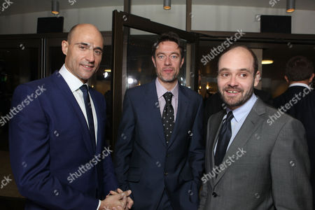 HOLLYWOOD, CA - DECEMBER 06: Mark Strong, Co-screenwriter Peter Straughan and David Dencik at Focus Features Premiere of 'Tinker Tailor Soldier Spy' held at ArcLight Hollywood on December 6, 2011 in Hollywood, California. Mark Strong Peter Straughan David Dencik