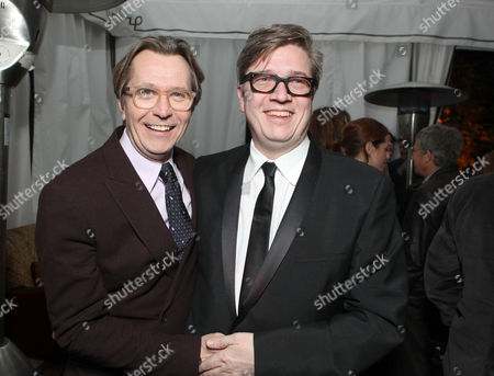 HOLLYWOOD, CA - DECEMBER 06: Gary Oldman and Director Tomas Alfredson at Focus Features Premiere of 'Tinker Tailor Soldier Spy' held at ArcLight Hollywood on December 6, 2011 in Hollywood, California. Gary Oldman Tomas Alfredson
