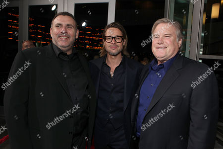HOLLYWOOD, CA - DECEMBER 08: GK Films' Graham King, Brad Pitt and Producer Tim Headington at FilmDistrict's Los Angeles Premiere of 'In the Land of Blood and Honey' held at ArcLight Hollywood on December 8, 2011 in Hollywood, California. Graham King Brad Pitt Tim Headington