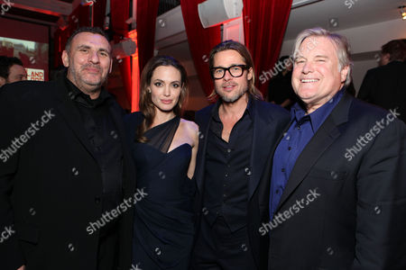 HOLLYWOOD, CA - DECEMBER 08: (EXCLUSIVE COVERAGE) GK Films' Graham King, Writer/Director Angelina Jolie, Brad Pitt and Producer Tim Headington at FilmDistrict's Los Angeles Premiere of 'In the Land of Blood and Honey' held at ArcLight Hollywood on December 8, 2011 in Hollywood, California. Graham King Angelina Jolie Brad Pitt Tim Headington