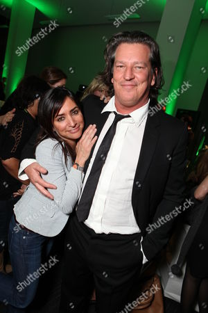 LOS ANGELES, CA - JANUARY 04: Pamela Adlon and Executive Producer Stephen Hopkins at Showtime Premiere of 'House of Lies' held at AT&T Center on January 4, 2012 in Los Angeles, California.