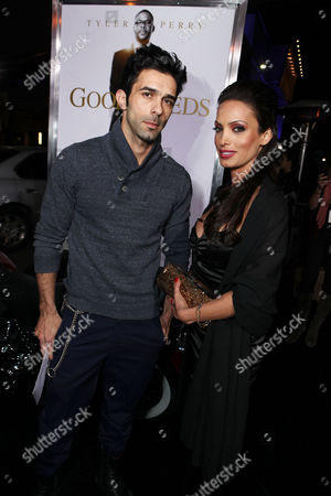 Stock Image of LOS ANGELES, CA - FEBRUARY 14: Yaniv Moyal and guest arrive at Lionsgate's World Premiere of 'Good Deeds' at Regal Cinemas L.A. Live on February 14, 2012 in Los Angeles, California. Yaniv Moyal