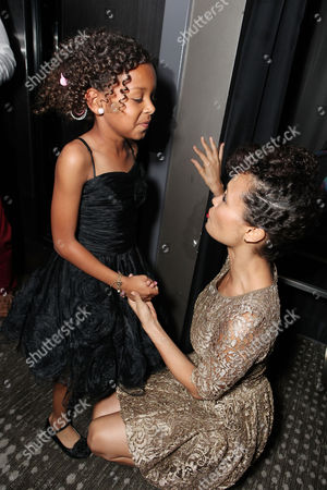Stock Image of LOS ANGELES, CA - FEBRUARY 14: Jordenn Thompson and Thandie Newton at Lionsgate's World Premiere of 'Good Deeds' at Regal Cinemas L.A. Live on February 14, 2012 in Los Angeles, California. Jordenn Thompson Thandie Newton