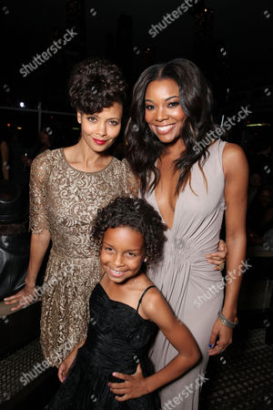 LOS ANGELES, CA - FEBRUARY 14: Thandie Newton, Jordenn Thompson (in front) and Gabrielle Union at Lionsgate's World Premiere of 'Good Deeds' at Regal Cinemas L.A. Live on February 14, 2012 in Los Angeles, California. Thandie Newton Jordenn Thompson Gabrielle Union