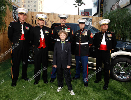 HOLLYWOOD, CA - APRIL 16: Riley Thomas Stewart (center front) with U.S. Marines at The World Premiere of Warner Bros.' 'The Lucky One' Presented by Dodge Ram at Grauman's Chinese Theatre on April 16, 2012 in Hollywood, California. (Photo by Le Studio/FilmMagic)Riley Thomas Stewart