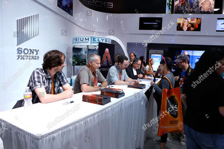 SAN DIEGO, CA - JULY 14: Beni Lobel, Michael Friedman and Gary Whitta at Sony Pictures 'After Earth' Autograph Signing At 2012 Comic-Con Convention at San Diego Convention Center on July 14, 2012 in San Diego, California. Beni Lobel Michael Friedman Gary Whitta
