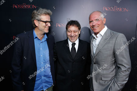 Stock Photo of HOLLYWOOD, CA - AUGUST 28: Director Ole Bornedal, producer Sam Raimi and executive producer Joe Drake arrive at Lionsgate's 'The Possession' Los Angeles Premiere at ArcLight Cinemas on August 28, 2012 in Hollywood, California. .Ole Bornedal Sam Raimi Joe Drake