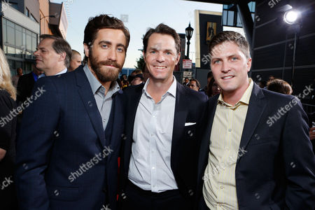 LOS ANGELES, CA - SEPTEMBER 17: Jake Gyllenhall with Open Road Films Executives Jason Cassidy and Ben Cotner at Open Road Films' 'End Of Watch' Premiere held at Regal Cinemas L.A. LIVE Stadium 14 on September 17, 2012 in Los Angeles, California. Ben Cotner Jason Cassidy Jake Gyllenhall